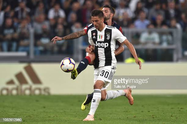 Rodrigo Bentancur of Juventus and Daniel Bessa of Genoa compete for the ball during the Serie A match between Juventus and Genoa CFC at Allianz...