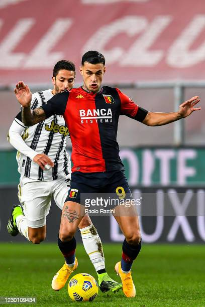 Rodrigo Bentancur of Juventus and Gianluca Scamacca of Genoa vie for the ball during the Serie A match between Genoa CFC and Juventus Fc at Stadio...