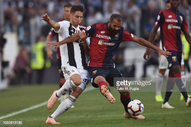 Rodrigo Bentancur of Juventus and Sandro of Genoa compete for the ball during the Serie A match between Juventus and Genoa CFC at Allianz Stadium on...