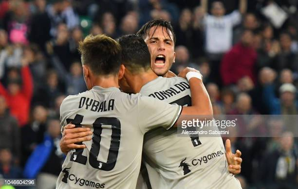 Rodrigo Bentancur of Juventus celebrates after scoring the opening goal whit team mates during the Serie A match between Udinese and Juventus at...