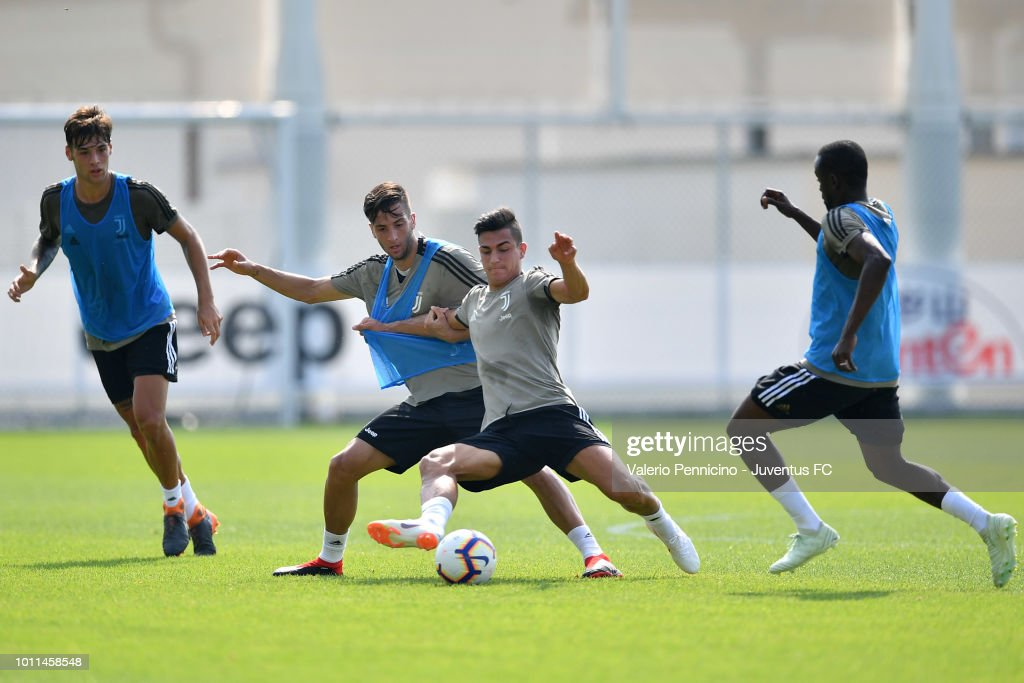 Rodrigo Bentancur (C) of Juventus competes during a training session at JTC on August 5, 2018 in Turin, Italy.