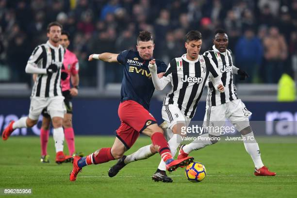 Rodrigo Bentancur of Juventus competes for the ball during the TIM Cup match between Juventus and Genoa CFC at Allianz Stadium on December 20 2017 in...