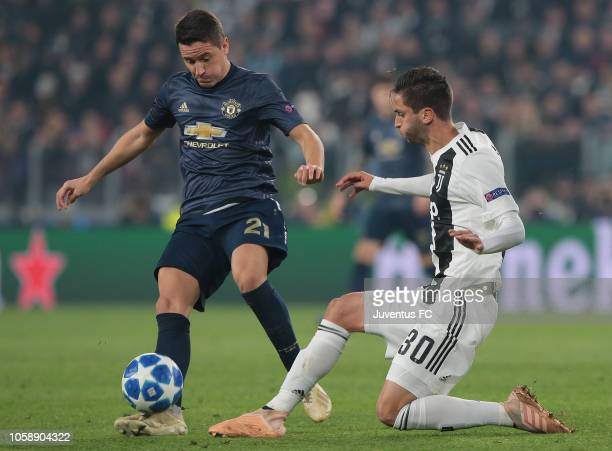Rodrigo Bentancur of Juventus competes for the ball with Ander Herrera of Manchester United during the Group H match of the UEFA Champions League...