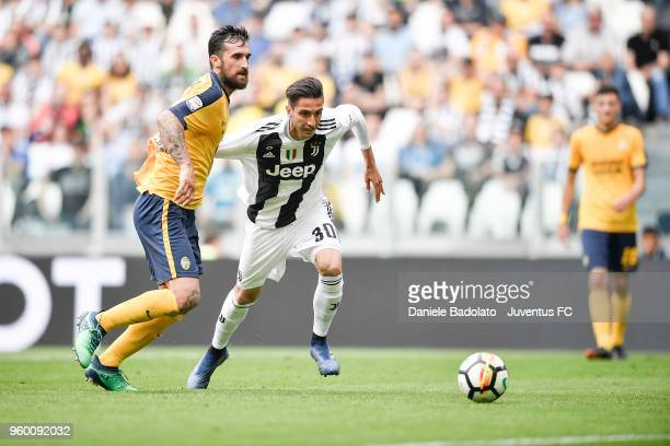 Rodrigo Bentancur of Juventus competes for the ball with Antonio Caracciolo of Hellas Verona FC during the serie A match between Juventus and Hellas...
