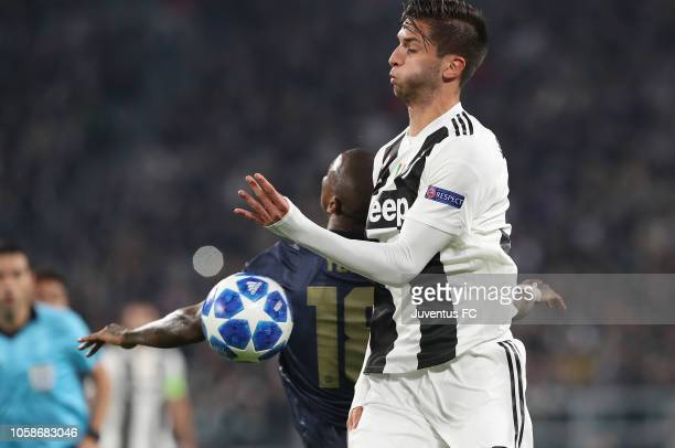 Rodrigo Bentancur of Juventus competes for the ball with Ashley Young of Manchester United during the Group H match of the UEFA Champions League...