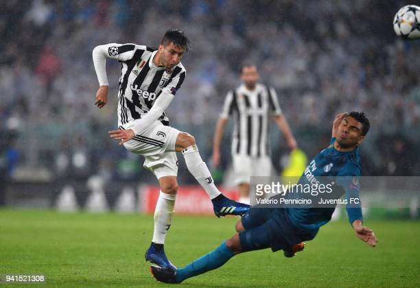 Rodrigo Bentancur of Juventus competes for the ball with Casemiro of Real Madrid during the UEFA Champions League Quarter Final Leg One match between...