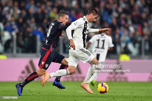 Rodrigo Bentancur of Juventus competes for the ball with Filip Bradaric of Cagliari during the Serie A match between Juventus and Cagliari on...