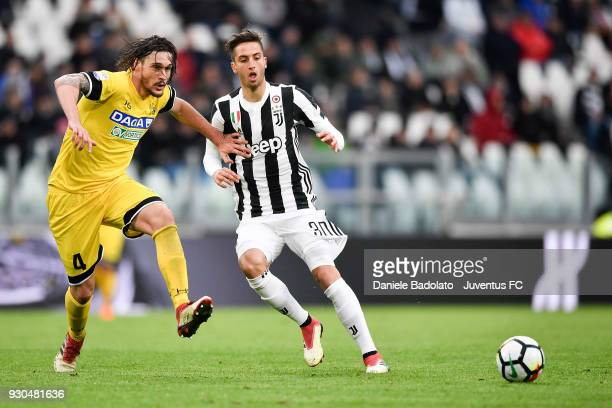 Rodrigo Bentancur of Juventus competes for the ball with Gabriele Angella of Udinese Calcio during the serie A match between Juventus and Udinese...