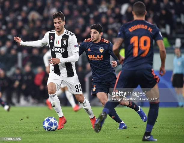 Rodrigo Bentancur of Juventus competes for the ball with Gonzalo Guedes of Valencia during the Group H match of the UEFA Champions League between...