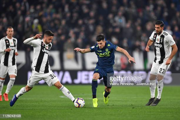 Rodrigo Bentancur of Juventus competes for the ball with Ignacio Pussetto of Udinese during the Serie A match between Juventus and Udinese at Allianz...