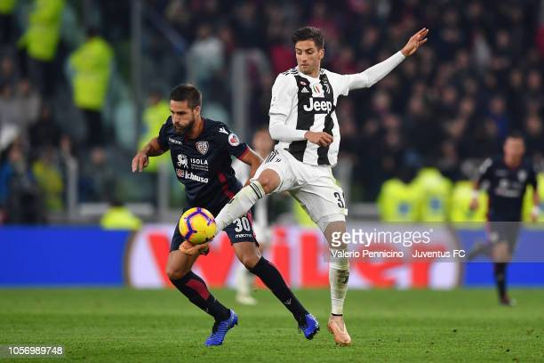 Rodrigo Bentancur of Juventus competes for the ball with Leonardo Pavoletti of Cagliari during the Serie A match between Juventus and Cagliari on...