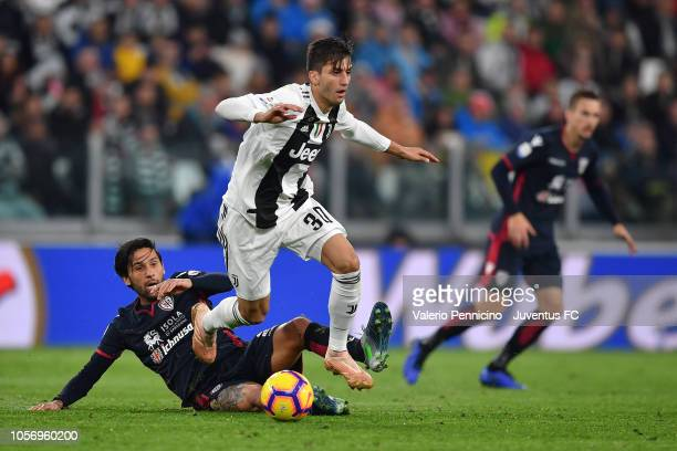 Rodrigo Bentancur of Juventus competes for the ball with Lucas Castro of Cagliari during the Serie A match between Juventus and Cagliari on November...