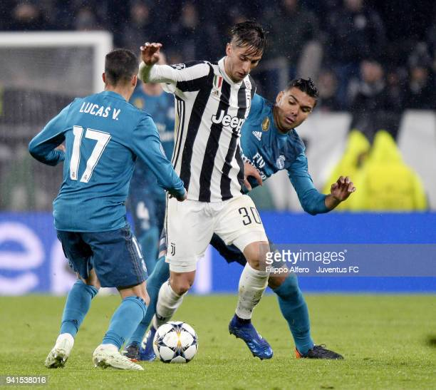 Rodrigo Bentancur of Juventus competes for the ball with Lucas Vazquez of Real Madrid during the UEFA Champions League Quarter Final Leg One match...