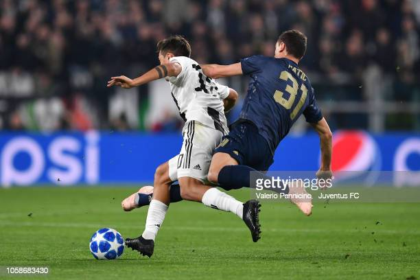 Rodrigo Bentancur of Juventus competes for the ball with Nemanja Matic of Manchester United during the Group H match of the UEFA Champions League...