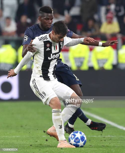 Rodrigo Bentancur of Juventus competes for the ball with Paul Pogba of Manchester United during the Group H match of the UEFA Champions League...