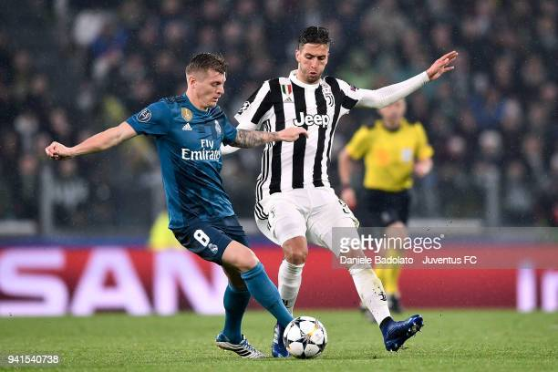 Rodrigo Bentancur of Juventus competes for the ball with Toni Kroos of Real Madrid during the UEFA Champions League Quarter Final Leg One match...