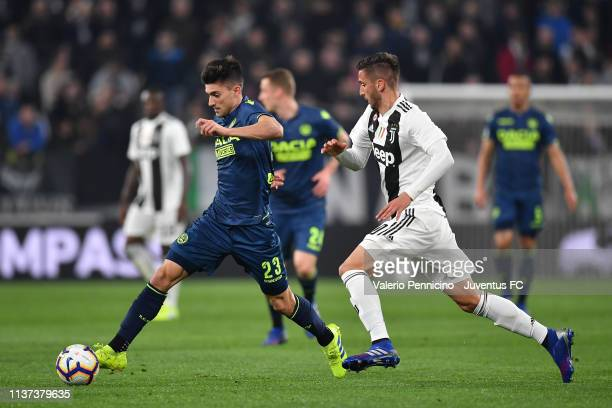 Rodrigo Bentancur of Juventus competes with Ignacio Pussetto of Udinese during the Serie A match between Juventus and Udinese at Allianz Stadium on...