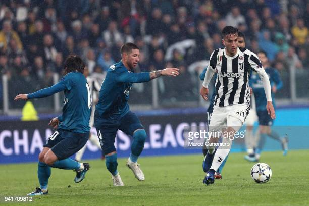Rodrigo Bentancur of Juventus FC and Sergio Ramos of Real Madrid Cf in action during the UEFA Champions League quarter final first leg football match...