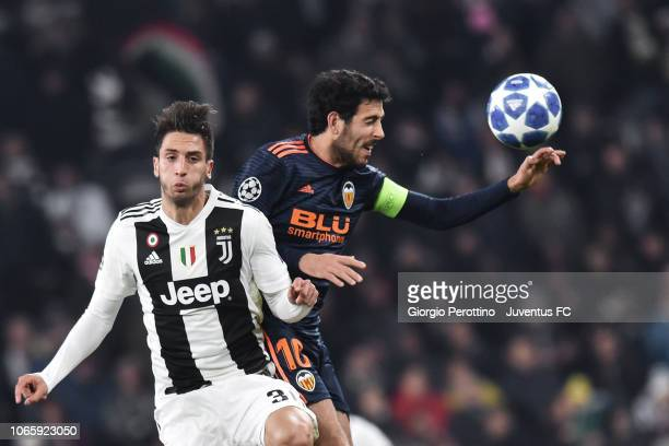 Rodrigo Bentancur of Juventus goes up with Daniel Parejo of Valencia during the Group H match of the UEFA Champions League between Juventus and...