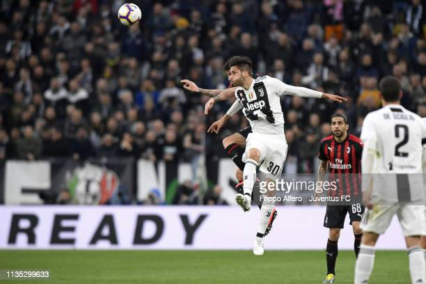 Rodrigo Bentancur of Juventus heads the ball during the Serie A match between Juventus and AC Milan on April 6, 2019 in Turin, Italy.
