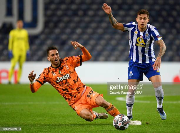Rodrigo Bentancur of Juventus is tackled by Otavio of FC Porto during the UEFA Champions League Round of 16 match between FC Porto and Juventus at...