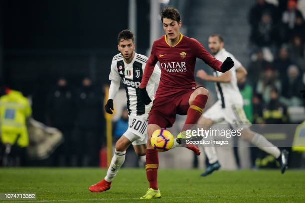 Rodrigo Bentancur of Juventus Patrik Schick of AS Roma during the Italian Serie A match between Juventus v AS Roma at the Allianz Stadium on December...