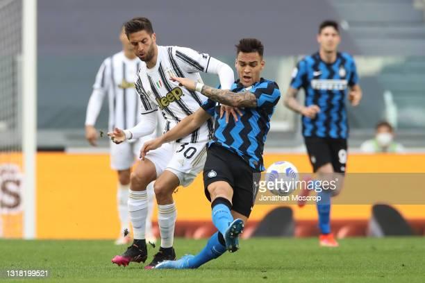 Rodrigo Bentancur of Juventus tussles with Lautaro Martinez of Internazionale during the Serie A match between Juventus and FC Internazionale at...