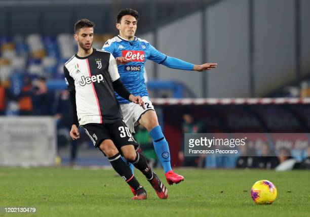 Rodrigo Bentancur of Juventus vies for the ball with Eljif Elmas of SSC Napoli during the Serie A match between SSC Napoli and Juventus at Stadio San...