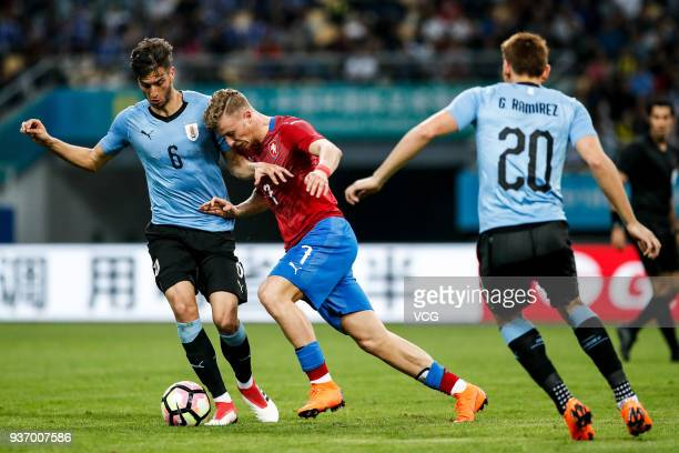 Rodrigo Bentancur of Uruguay and Antonin Barak of Czech Republic compete for the ball during the 2018 China Cup International Football Championship...