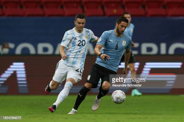 Rodrigo Bentancur of Uruguay fights for the ball with Giovani Lo Celso of Argentina during a group A match between Argentina and Chile as part of...