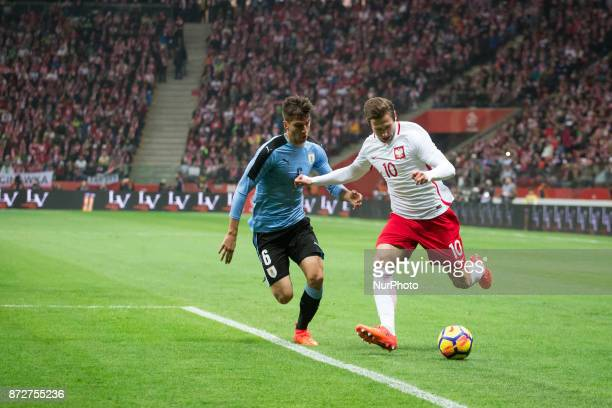 Rodrigo Bentancur vies Grzegorz Krychowiak during the international friendly soccer match between Poland and Uruguay at the PGE National Stadium in...