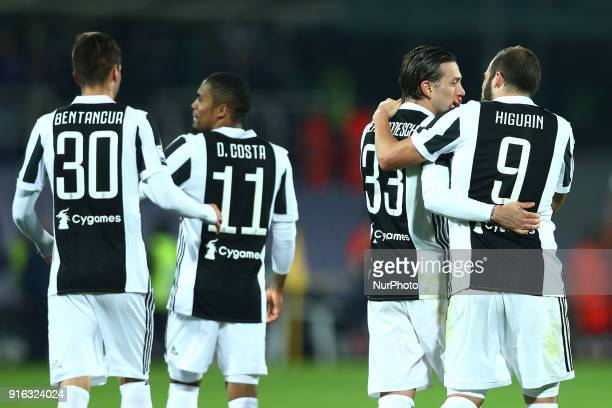 Rodrigo Bentancur with Douglas Costa and Federico Bernardeschi with Gonzalo Higuain of Juventus during the serie A match between ACF Fiorentina and...