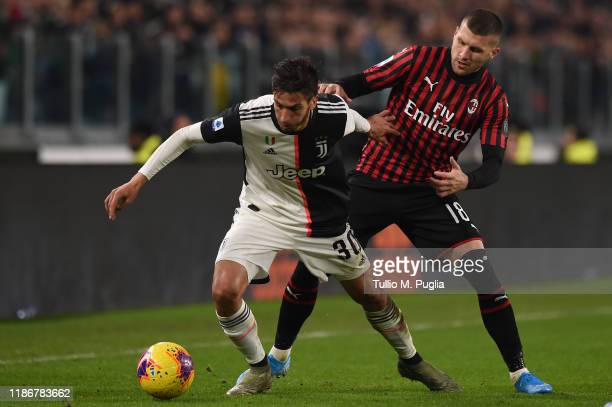 Rodrigo Betancur of Juventus and Ante Rebic of Milan fight for the ball during the Serie A match between Juventus and AC Milan at Allianz Stadium on...