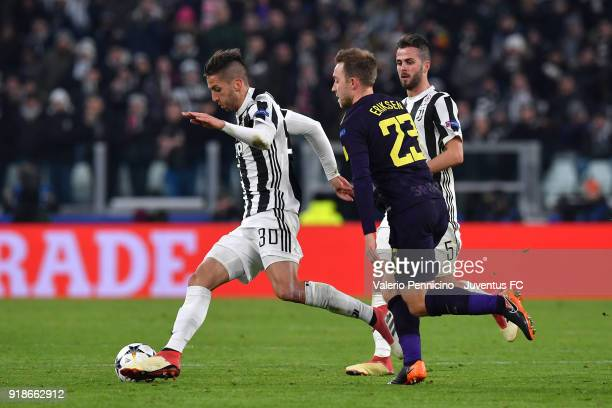 Rodrigo Betancur of Juventus is challenged by Christian Eriksen of Tottenham Hotspur during the UEFA Champions League Round of 16 First Leg match...