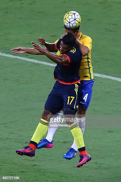 Rodrigo Caio of Brazil struggles for the ball with Orlando Berro of Colombia during a match between Brazil and Colombia as part of Friendly Match In...