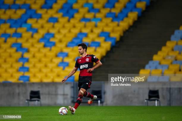 Rodrigo Caio of Flamengo runs with the ball during the match between Flamengo and Fluminense as part of the Taca Rio the Second Leg of the Carioca...