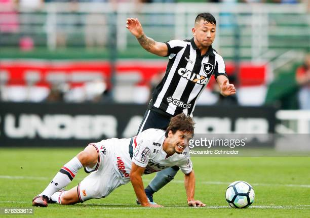 Rodrigo Caio of Sao Paulo and Rodrigo Lindoso of Botafogo in action during the match for the Brasileirao Series A 2017 at Pacaembu Stadium on...