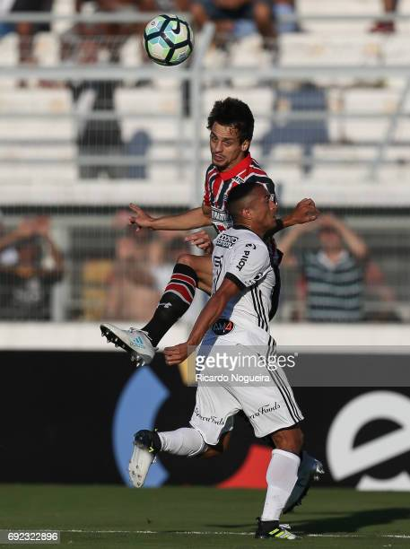 Rodrigo Caio of Sao Paulo battles for the ball with Nino Paraiba of Ponte Preta during the match between Ponte Preta and Sao Paulo as a part of...