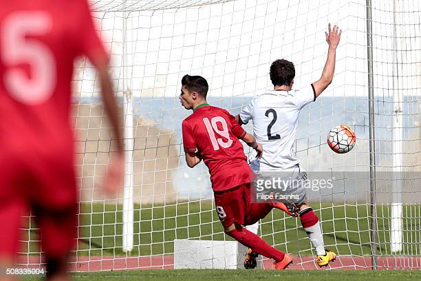 Rodrigo Conceicao of Portugal scores the third goal challenging Andriko Smolinski of Germany during the UEFA Under16 match between U16 Portugal and...
