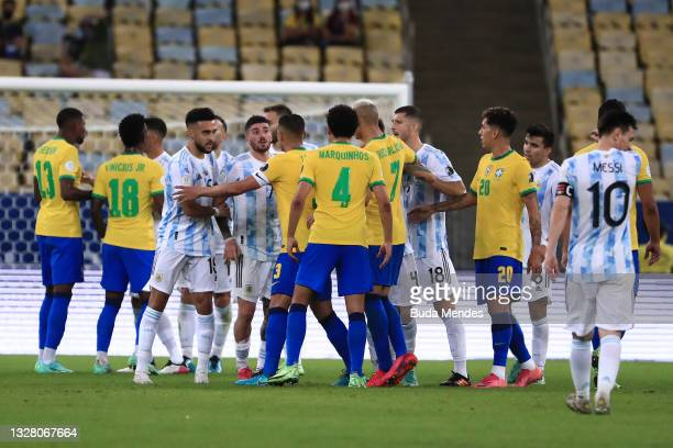 Rodrigo De Paul of Argentina and teammates argue with Richarlison of Brazil and teammates during the final of Copa America Brazil 2021 between Brazil...