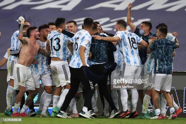 Rodrigo De Paul of Argentina and teammates celebrate winning the final of Copa America Brazil 2021 between Brazil and Argentina at Maracana Stadium...