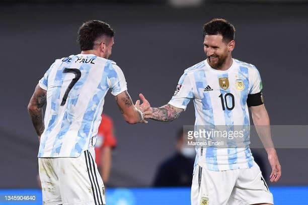 Rodrigo De Paul of Argentina celebrates with teammate Lionel Messi after scoring Rodrigo De Paul of Argentina during a match between Argentina and...