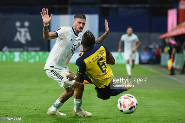 Rodrigo de Paul of Argentina competes for the ball with Pervis Estupiñán of Ecuador during a match between Argentina and Ecuador as part of South...