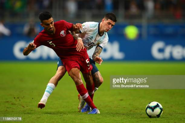 Rodrigo De Paul of Argentina in action with Tarek Salman of Qatar during the Copa America Brazil 2019 group B match between Qatar and Argentina at...