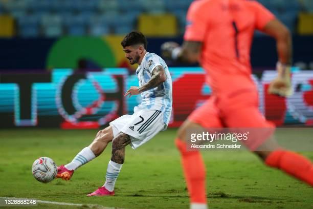 Rodrigo De Paul of Argentina kicks the ball to score the the first goal of his team during a quarter-final match of Copa America Brazil 2021 between...