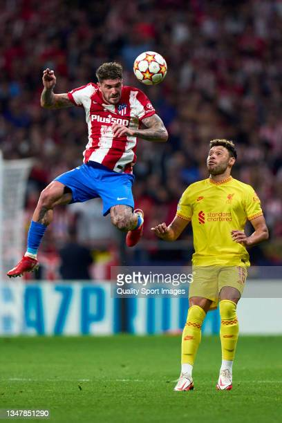 Rodrigo de Paul of Atletico de Madrid battle for the ball with Alex Oxlade-Chamberlain of Liverpool FC during the UEFA Champions League group B match...