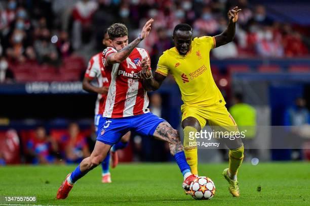 Rodrigo De Paul of Club Atletico de Madrid and Sadio Mane of Liverpool FC during the Group B - UEFA Champions League match between Club Atletico de...