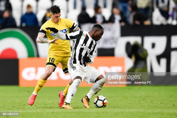 Rodrigo De Paul of Udinese and Kwadwo Asamoah of Juventus during the serie A match between Juventus and Udinese Calcio on March 11 2018 in Turin Italy
