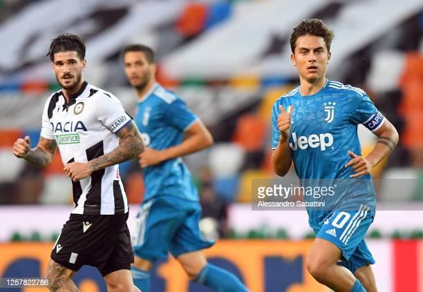 Rodrigo De Paul of Udinese Calcio and Paulo Dybala of Juventus during the Serie A match between Udinese Calcio and Juventus at Stadio Friuli on July...