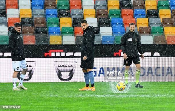 Rodrigo de Paul of Udinese Calcio and Rafael Toloi of Atalanta BC and Referee Federico La Penna before the Serie A match between Udinese Calcio and...